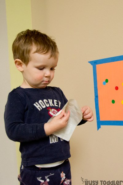 TABY DOT STICKER WALL: A quick and easy dot sticker activity for tabies; young toddlers sticker wall; baby activity; toddler fine motor skill activity; quiet time activity; rainy day activity; indoor activity from Busy Toddler