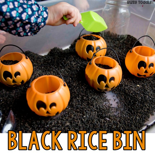 BLACK RICE SENSORY BIN: Have you made a Halloween sensory bin yet? Halloween activity; Halloween toddler activity; Halloween preschool activity; indoor activity; sensory bin activity from Busy Toddler
