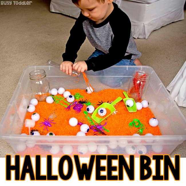 Halloween Sensory: Check out this super easy Halloween sensory bin; orange rice bin; dollar store sensory bin; Halloween activities for toddlers; Halloween activities for preschoolers; easy Halloween ideas from Busy Toddler