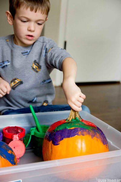 PAINTING PUMPKINS: A quick and easy process art activity; Halloween art activity; pumpkin art activity; kids Halloween activity; toddler Halloween activity; preschool Halloween activity from Busy Toddler