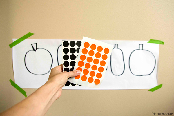 HALLOWEEN DOT STICKERS: They make orange and black dot stickers! Halloween activities for toddler; five little pumpkins; preschool halloween; halloween ideas; easy indoor ideas; easy fall activities for toddlers from Busy Toddler