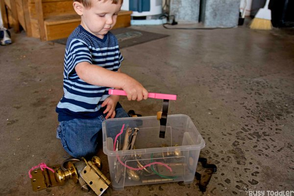 MAGNETIC EXPLORATION: A quick and easy toddler activity; toddler STEM activity; science activity for toddlers; magnets; STEM bin; easy indoor activity from Busy Toddler