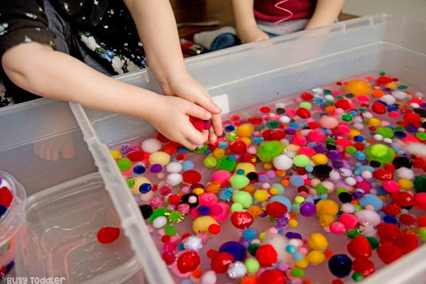 POM POM SOUP SENSORY BIN: A quick and easy toddler activity; preschool activity; easy indoor activity; pom pom balls activity; rainy day activity from Busy Toddler