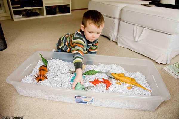 DINOSAUR SENSORY BIN: A quick and easy toddler activity; a fun preschool activity; sensory bin activity; indoor activity; rainy day activity; winter activity from Busy Toddler