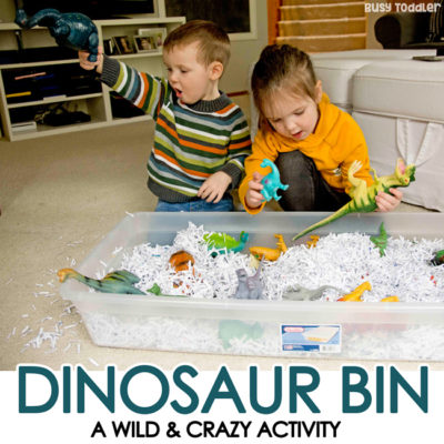 Dinosaur Sensory Bin with Shredded Paper