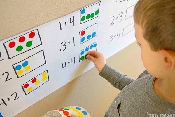 DOT STICKER ADDITION:  A skill building math activity; learning addition; kindergarten math activity; easy indoor preschool activity; kindergarten skill building activity by Busy Toddler