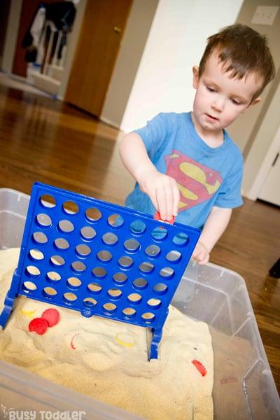 CONNECT 4 SENSORY BIN: A fun sensory activity for toddlers; indoor toddler activity; taby activity; play-based learning activity; rainy day activity; easy toddler activity from Busy Toddler