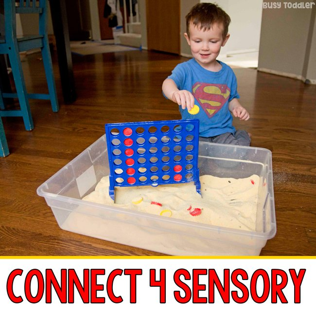 CONNECT 4 SENSORY BIN: A fun sensory activity for toddlers; indoor toddler activity; taby activity; play-based learning activity; rainy day activity; easy toddler activity from Busy Toddler