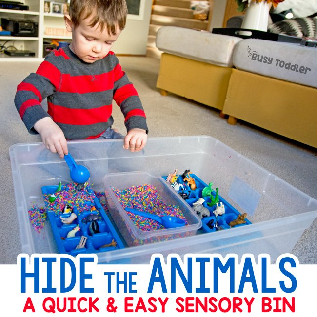 HIDDEN ANIMALS: A quick and easy sensory bin activity; sensory learning for toddlers; toddler activity; quick and easy toddler activity; rainy day activity; rainbow rice activity from Busy Toddler