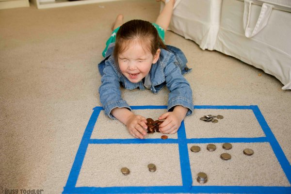 COIN SORTING: A preschool math activity; learning money activity; kindergarten math activity; hands-on math; hands-on learning activity; play to learn activity; preschool activity from Busy Toddler