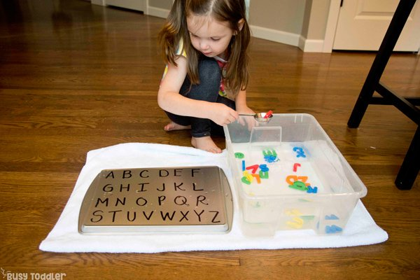 ALPHABET SOUP SENSORY - A quick and easy preschool literacy activity; teaching kids letter names; learning about letters; alphabet activity for preschoolers; preschool activity; sensory bin activity from Busy Toddler