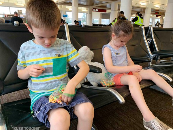 AIRPLANE TRAVEL SNACKS for kids: The best activity for traveling with kids; entertaining kids on a road trip; entertaining kids on an airplane; ways to keep kids busy while traveling by Busy Toddler