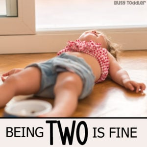 A toddler tantrum on the floor as part of the Being Two is Fine PSA from Busy Toddler