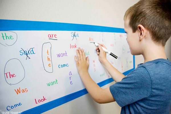 Kindergartener working on a sight words activity to help memorize tricky words in a simple activity from Busy Toddler