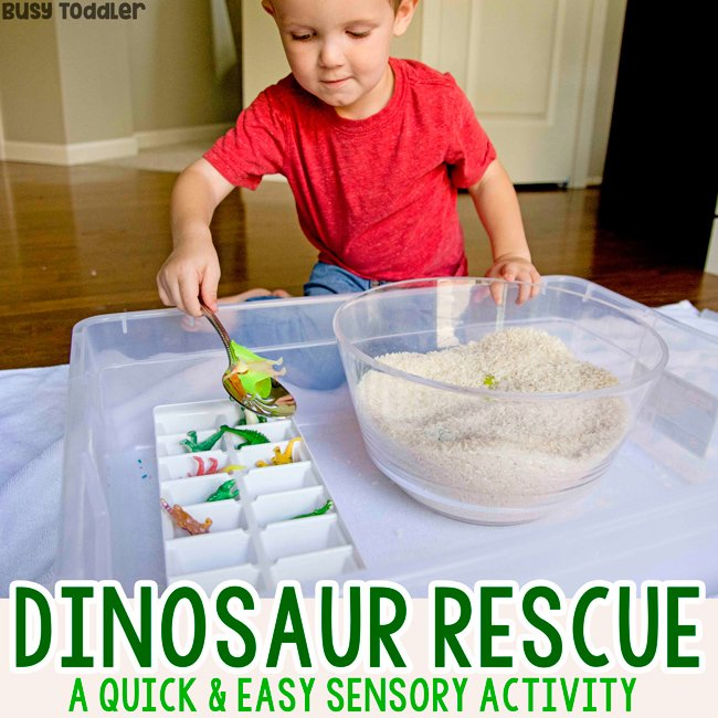A toddlerdoing a sensory bin activity rescuring dinosaurs from a rice trap in a quick and easy activity from Busy Toddler