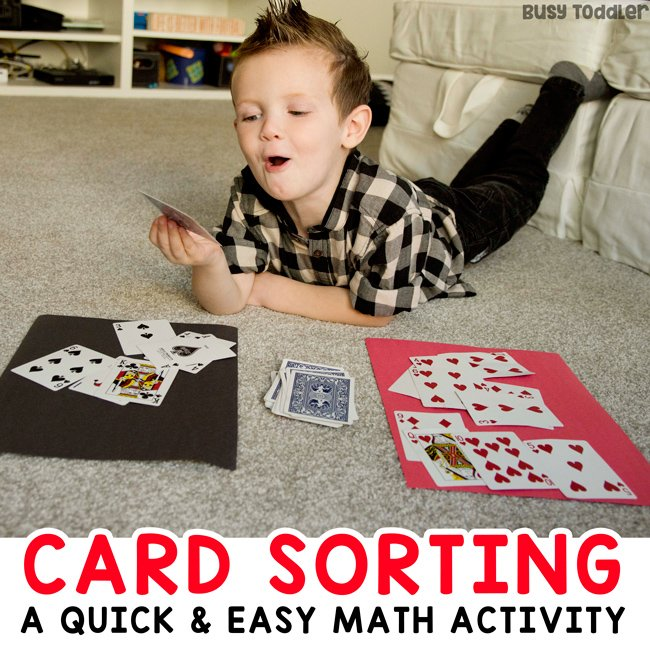 Toddler doing a math activity sorting cards in a quick and easy activity from Busy Toddler