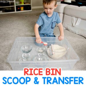 RICE BIN TODDLER ACTIVITY - A toddler playing with a simple scoop and transfer activity inspired by Montessori at home play in a quick and easy activity from Busy Toddler
