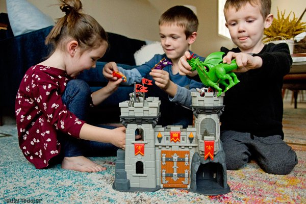 Siblings playing with a castle toys from Lakeshore Learning