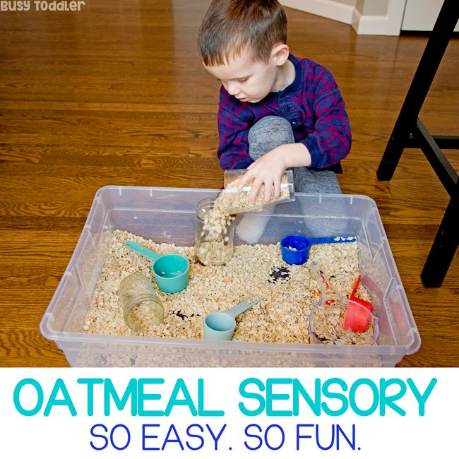 OATMEAL SENSORY BIN - A quick and easy toddler activity using just dry oatmeal. A taste-safe sensory bin for toddlers to play with as a great indoor activity option from Busy Toddler