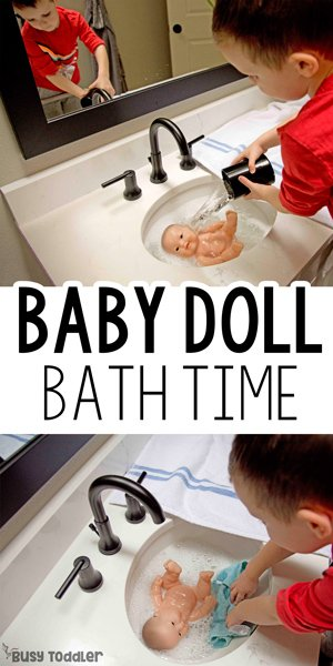 Toddler giving his baby doll a bath in a quick and easy sensory activity from Busy Toddler