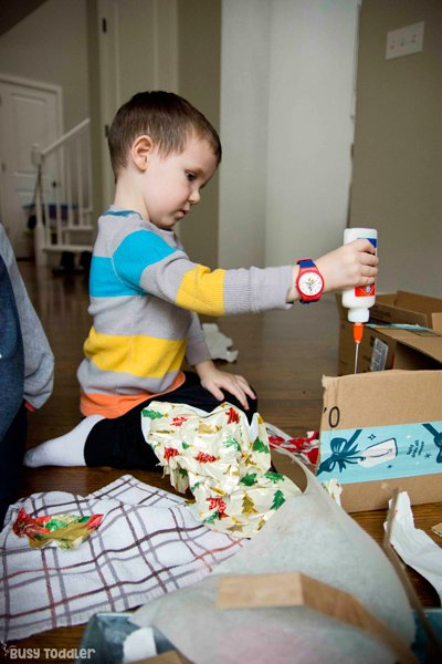 A creation station filled you materials and supplies for children to tinker with as they learn more about cutting and gluing from Busy Toddler