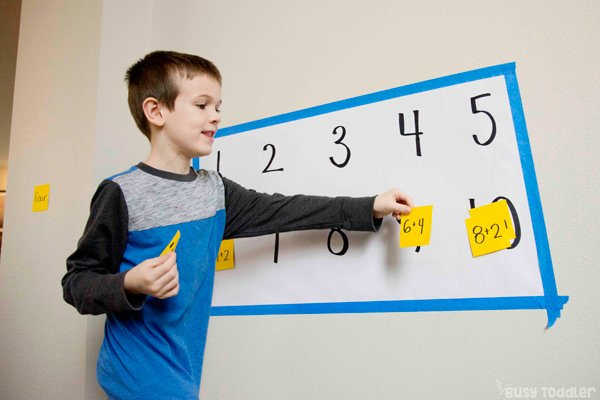 A kindergarteners working on a number match activity designed to help them learn common core state standards in math