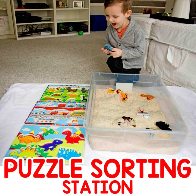 PUZZLE SORTING STATION: A quick and easy toddler activity using puzzles! Makes a sorting station for your toddler to play with their chunky puzzles. An easy indoor activity for toddlers and preschoolers; a sensory bin activity from Busy Toddler