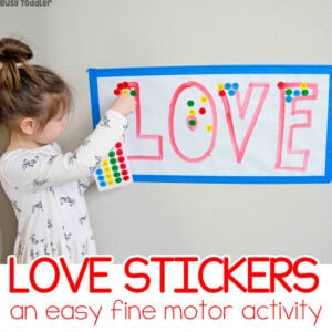 LOVE STICKERS ACTIVITY: A quick and easy preschool Valentine's Day activity; a dot sticker activity; easy literacy activity for preschoolers; preschoolers learning the ABCs from Busy Toddler