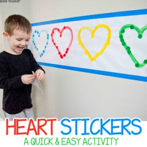 HEART STICKERS ACTIVITY: A quick and easy Valentine's Day activity from Busy Toddler; easy indoor activity; dot stickers activity; sorting activity; fine motor skills activity for toddlers