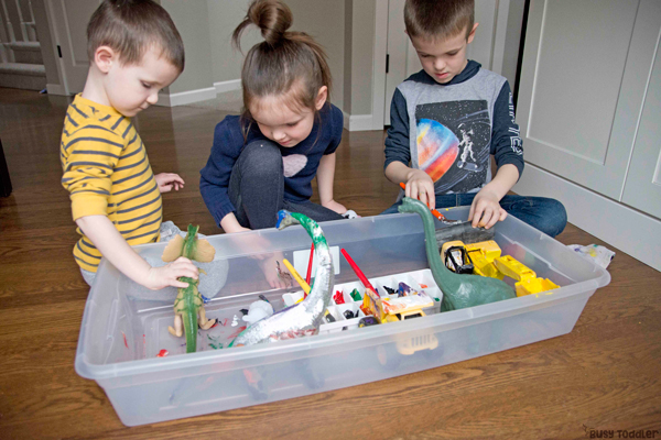 Kids painting their toys in a fun and easy activity from Busy Toddler