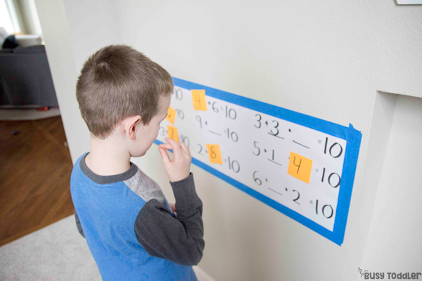 Kindergartener doing a hands-on math activity adding to 10