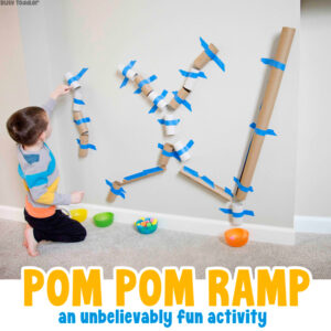 POM POM TOY RAMP: A quick and easy toddler activity using paper tubes; this is such a fun activity on a rainy day; a recycled activity for kids from Busy Toddler