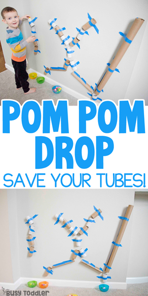 Toddler doing a quick and easy kids activity using paper tubes and pom pom balls from Busy Toddler
