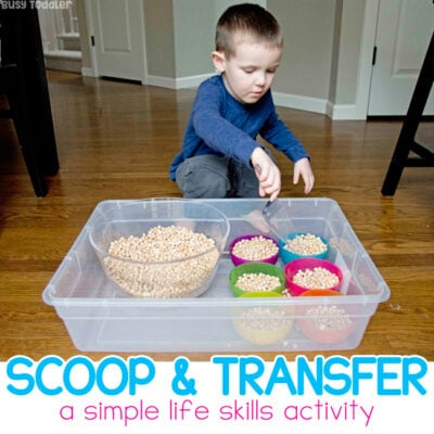 Toddler Scooping Activity: This is one of the best kinds of activities for toddlers learning to scoop and transfer. An easy sensory activity with Montessori roots. An easy indoor activity for a rainy day from Busy Toddler