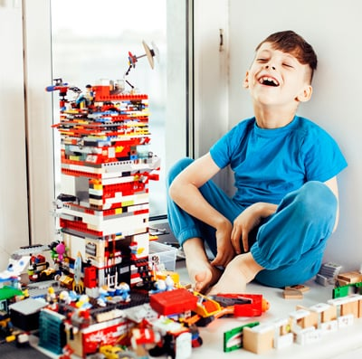 Boy playing legos