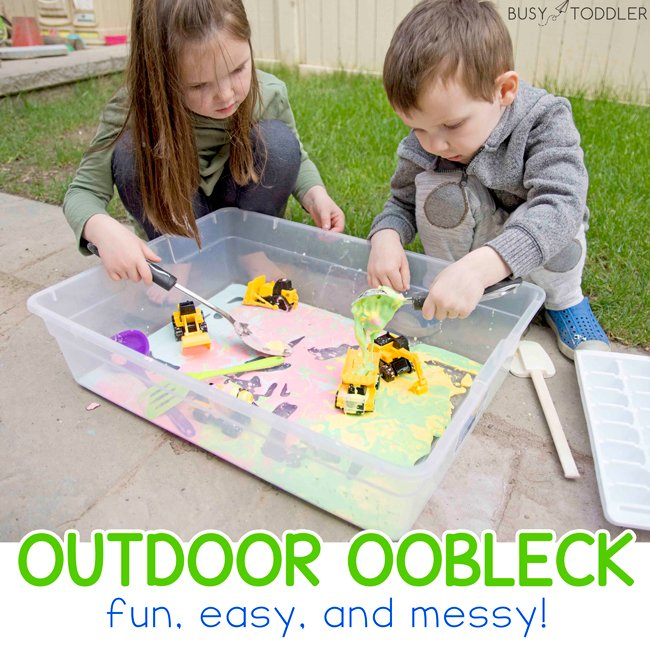 OUTDOOR OOBLECK: Take messy play outside with this fun and easy oobleck activity from Busy Toddler. Make rainbow oobleck for your kids. A great backyard / outdoor activity for kids.