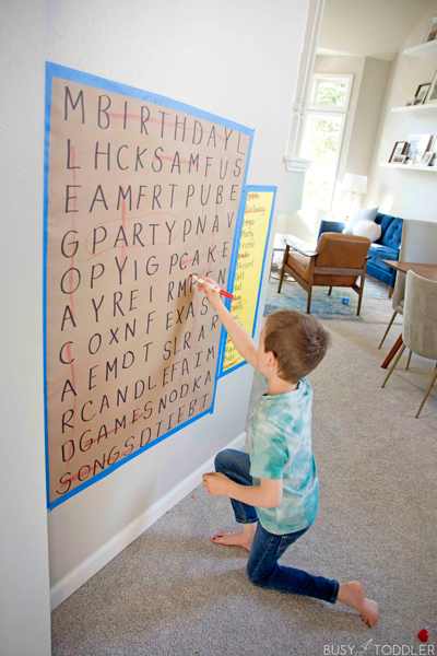 Child doing a word search on their birthday made out of personalized words and in a giant format.