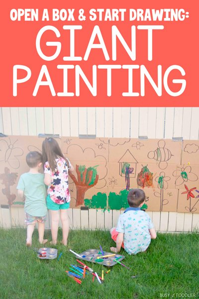 Kids painting on a cardboard box with a giant art project.
