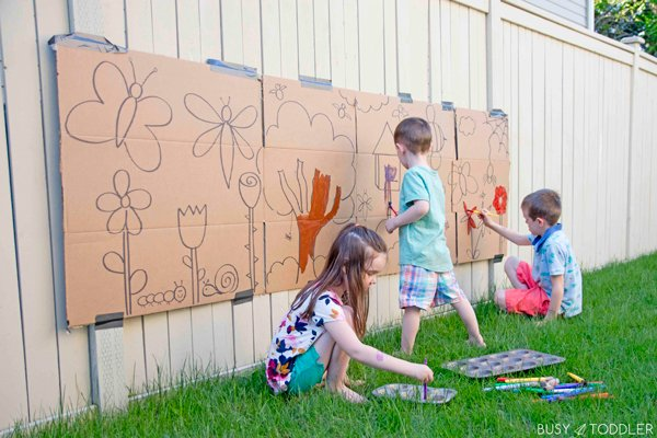 Kids having fun at a giant activity painting outside