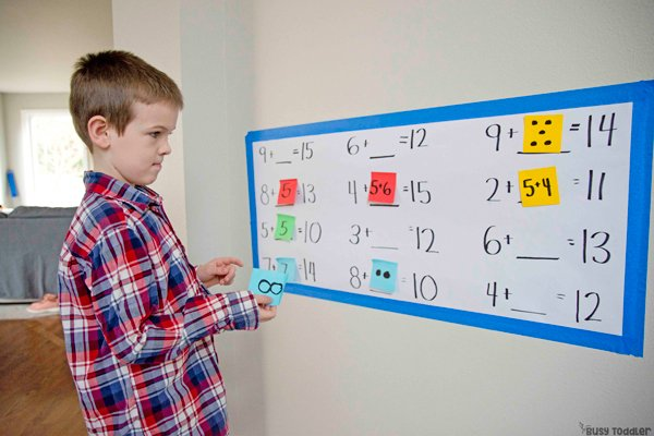 A child doing an algebra based activity from Busy Toddler