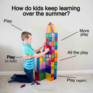 How do kids keep learning over the summer? Child playing at magnetic tiles learning by doing.