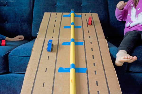 A cardboard ramp for cars from Busy Toddler