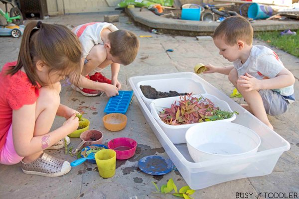 Kids playing with a mud kitchen