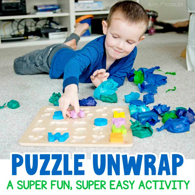 PUZZLE UNWRAP: A quick and easy kids activity - just wrap up puzzle pieces. A fun indoor activity for kids from Busy Toddler