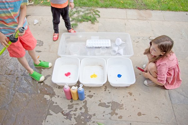 Water dyed with tempera paint in a fun kids activity