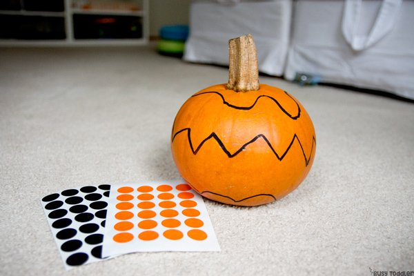 A pumpkin ready to be decorated with dot stickers