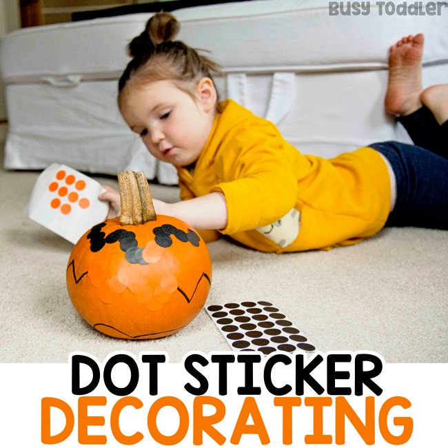 HALLOWEEN DOT STICKER DECORATING: Looking for a fun and easy Halloween activity? Grab the dot stickers and a pumpkin - we LOVE this activity. It's a winner every Halloween for all ages - from Busy Toddler