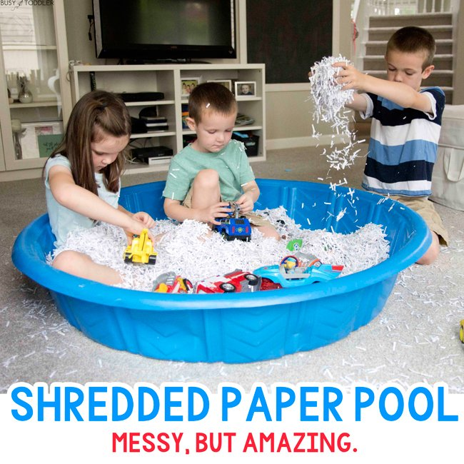 SHREDDED PAPER SENSORY BIN:  Check out this amazing (and messy) sensory bin from Busy Toddler! This unexpected fun is so perfect on a rainy day. Kids love playing with this sensory bin.