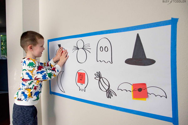 Toddler playing with a Halloween activity