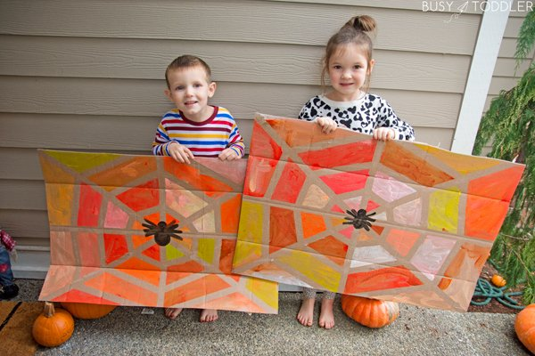 SPIDER WEB TAPE RESIST ART: The best Halloween activity of all! This tape resist art activity was the best way to play with Halloween for kids of all ages from Busy Toddler.